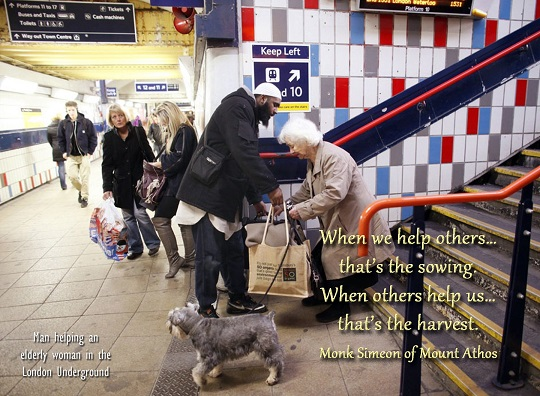 """Hussain, a 34 year old Muslim convert, helps an elderly lady with her bags at a train station in London, December 5, 2011. Hussain, formerly Jason Thomas, whose family are Christians and originate from the Caribbean, adopted the religion after a troublesome upbringing saw him end up homeless and eventually imprisoned.  """"I got involved in robbing shops and business people and stealing designer clothes from the West End's expensive shops. My life consisted of waking up in the morning, smoking weed, hanging out on the council estate and doing crime,"""" he said.  """"But when I was in prison, I thought there must be more to life than just robbing and stealing."""" Thomas, who now visits socially deprived areas and counsels troubled youths against committing crime, was taken to the Brixton Mosque in South London by his cousin, who introduced him to Islam. Picture taken December 5, 2011.        REUTERS/Danish Siddiqui (BRITAIN - Tags: RELIGION SOCIETY)"""