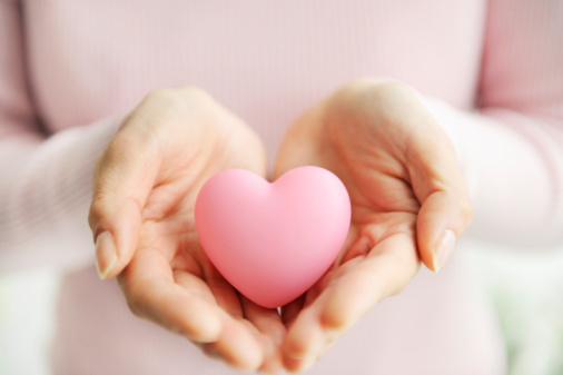Woman holding a pink heart
